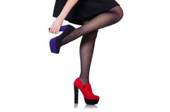 Jambes de femme avec les chaussures rouges Images stock