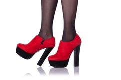 Jambes de femme avec les chaussures rouges Photographie stock