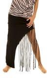 Jambes de femme dans une jupe frangeante photo stock