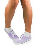 Jambes de fille timide photo stock