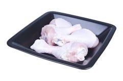 Jambes de poulet d'un plat Image stock