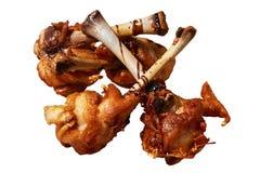 Jambes de poulet rôti d'isolement sur le fond blanc photo stock