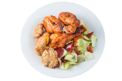 Jambes de poulet tandooris avec de la salade Photo libre de droits