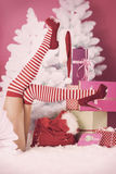 Jambes de Santa femelle Photographie stock