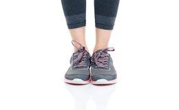 Jambes femelles dans les vêtements de sport Photographie stock