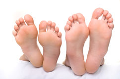 Jambes femelles et jambes masculines Photo stock