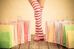 Jambes sexy de femme de Santa Photo libre de droits