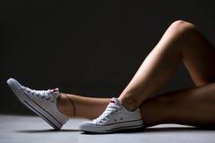 Jambes sexy de femme sportive Photographie stock