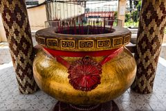 Jambi, Indonesia - October 7, 2018 : Giant joss stick pot with red incense stick at Chinese temple royalty free stock photography