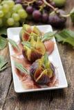 Jambon avec la figue fraîche Photographie stock