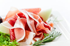 Jambon avec le melon Photo stock
