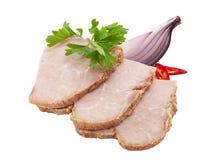 Jambon cuit coupé en tranches d'isolement sur le blanc image libre de droits