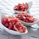 Jambon espagnol coupé de serrano Photos stock