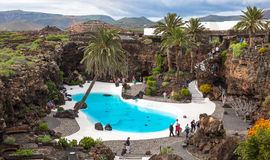 Jameos del Agua, in Lanzarote, Canary Islands, Spain. LANZAROTE, SPAIN - NOVEMBER 29, 2016: people at the Jameos del Agua, part of a 6Km long lava tube which stock photo