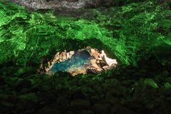 Jameos del Agua in Lanzarote, cave of volcanic origin illuminated with green light and a lake inside. Canary Island stock images