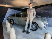 James Bond and Aston Martin. Statue of James Bond leaning against the iconic Aston Martin DB5 from the movie Goldfinger Royalty Free Stock Photos