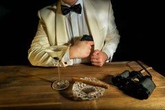 James Bond. With gun, Vodka Martini and binoculars Royalty Free Stock Photos