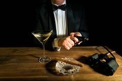 James Bond. With gun, Vodka Martini and binoculars Royalty Free Stock Photo