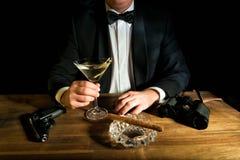 James Bond. With gun, Vodka Martini and binoculars Royalty Free Stock Image