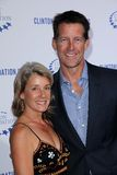 James Denton. And wife  at the Clinton Foundation Gala in Honor of A Decade of Difference,  Palladium, Hollywood, CA 10-14-11 Royalty Free Stock Images
