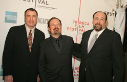 James Gandolfini, John Travolta, and Todd Robinson. Actors James Gandolfini, John Travolta, and Todd Robinson arrive on the red carpet for the premiere of Lonely Royalty Free Stock Photography