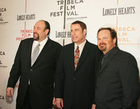 James Gandolfini, John Travolta, and Todd Robinson. Actors James Gandolfini, John Travolta, and Todd Robinson  arrive on the red carpet for the premiere of Royalty Free Stock Images