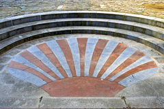 James Scallop shell as artwork used in paving, Huy Royalty Free Stock Image