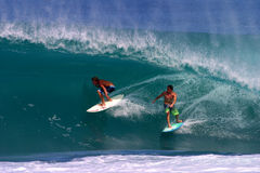 Jamie O'brien and Kalani Chapman Surfing a Wave Royalty Free Stock Photos