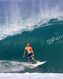 Jamie O'brien Surfing a Wave at Pipeline Hawaii. Pipeline Pro Surfing Champion, Jamie O'brien, riding a nice wave at Pipeline on the North Shore of Oahu, Hawaii Stock Photo