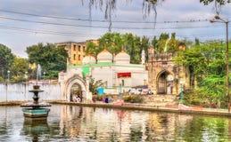 Jamil Baig Masjid Mosque and Mahmud Darwaza Gate as seen from Panchakki Water Mill. Aurangabad, India Stock Photos