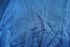 Jammed blue cotton fabric from above Stock Photo