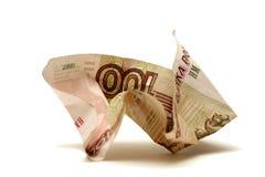 Jammed money. Isolated on white background Stock Image