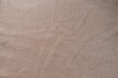 Jammed beige polyester fabric with sparkling fiber. Jammed pale beige polyester fabric with sparkling fiber Royalty Free Stock Photo