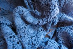 Jammed pale blue old-fashioned lacy fabric. Jammed pale blue old fashioned lacy fabric Royalty Free Stock Photography