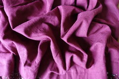 Jammed pale plum colored linen fabric. Jammed pale plum colored simple linen fabric Royalty Free Stock Photography