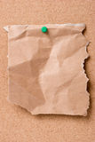 Jammed paper on cork board. Jammed paper pinned on cork board Royalty Free Stock Image