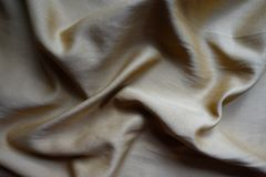 Jammed simple smooth light greyish golden fabric. Jammed simple smooth light grayish golden fabric Royalty Free Stock Image