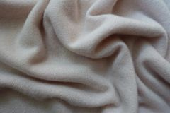 Jammed simple white fluffy woolen knitted fabric. Jammed simple white fluffy woollen knitted fabric Royalty Free Stock Images