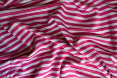 Jammed striped fabric in pink and white. From above Royalty Free Stock Photos