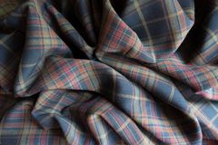 Jammed thick plaid fabric in subdued colors. Jammed thick plaid fabric  in subdued colors Stock Images