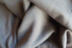 Jammed thin light grey jersey fabric. Jammed thin simple light grey jersey fabric Stock Images