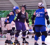Jammer and defender enjoy a light moment roller derby match Royalty Free Stock Images