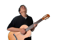 Jamming the guitar. Young man standing playing an acoustic guitar Stock Photography