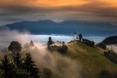 Free Jamnik, Slovenia - Magical Foggy Summer Morning At Jamnik St.Primoz Hilltop Church At Sunrise With Fog Stock Photography - 207090392