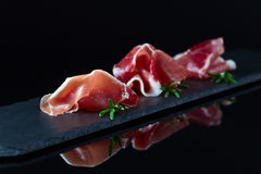 Jamon on a black background stock images