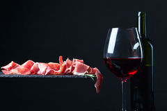 Jamon et vin rouge Image stock