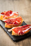 Jamon iberico tapas. Jamon iberico, the best spanish ham tapas. Vertical copy space Royalty Free Stock Photo