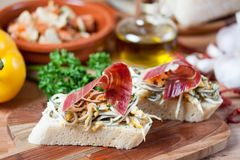 JAMON IBERICO ON TOAST. FOOD Stock Photo