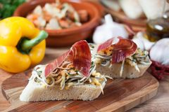 JAMON IBERICO ON TOAST. FOOD Royalty Free Stock Photos