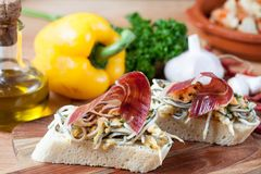 JAMON IBERICO ON TOAST. FOOD Stock Photography